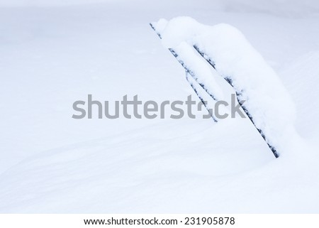 Windshield wipers covered in snow - stock photo