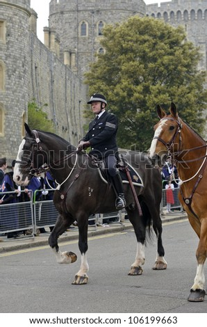 WINDSOR, BERKSHIRE, ENGLAND - MAY 19: Unidentified mounted police escorting Queens Diamond Jubilee Great Parade on May 19, 2012 in Windsor, Berkshire, England.