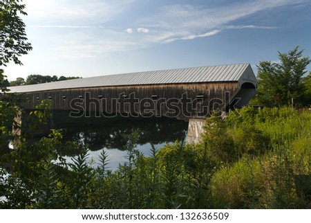 Windsor-Cornish bridge is the longest covered bridge in New England. It crosses between New Hampshire and Vermont, over the Connecticut River.