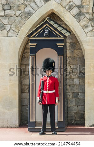 WINDSOR, ENGLAND - MAY 27, 2013: Changing Guard takes place in Windsor Castle. British Guards in red uniforms are among the most famous in the world. - stock photo