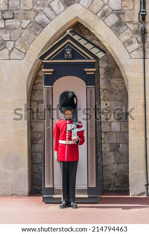 WINDSOR, ENGLAND - MAY 27, 2013: Changing Guard takes place in Windsor Castle. British Guards in red uniforms are among the most famous in the world.