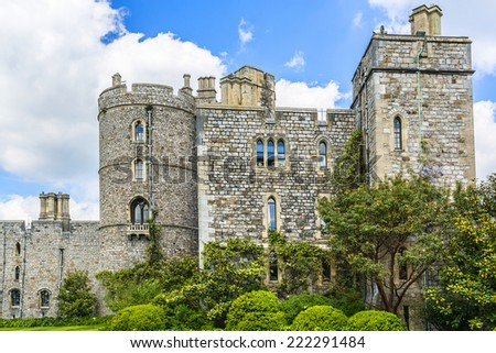 WINDSOR, ENGLAND - MAY 27, 2013: Outside view of Medieval Windsor Castle. Windsor Castle is a royal residence at Windsor in the English county of Berkshire. - stock photo