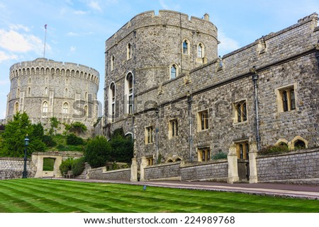 WINDSOR, ENGLAND - SEPTEMBER 14, 2014: Outside view of Medieval Windsor Castle. Windsor Castle is a royal residence at Windsor in the English county of Berkshire.  - stock photo