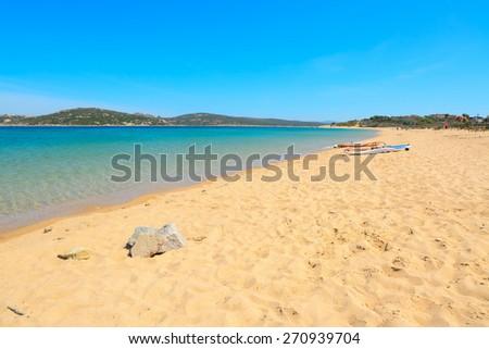 windsurf board on the sand in Porto Pollo, Sardinia - stock photo