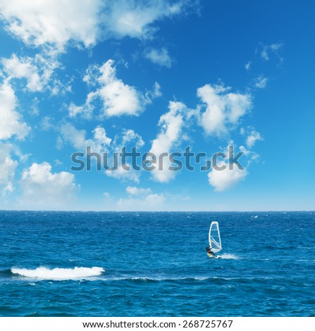 windsurfer alone on a cloudy day