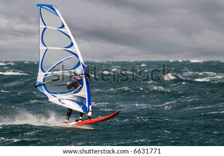 windsurfer on a stormy day close up shoot - stock photo