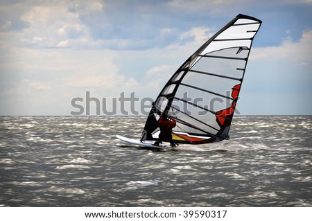 windsurfers in Baltic sea during competition open water - stock photo