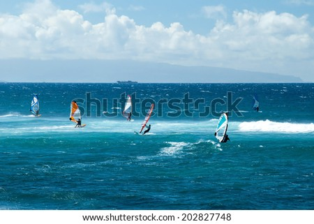Windsurfers in windy weather on Maui Island - stock photo