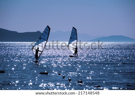 Windsurfing, unfocused - stock photo