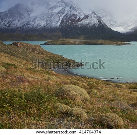 Windswept blue waters of Lago Nordenskjold in the wilderness of Torres del Paine National Park in the Magallanes region of Chile - stock photo