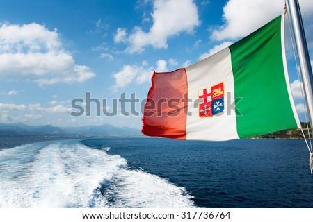 Windswept flag of Italian Navy (Marina Militare). - stock photo