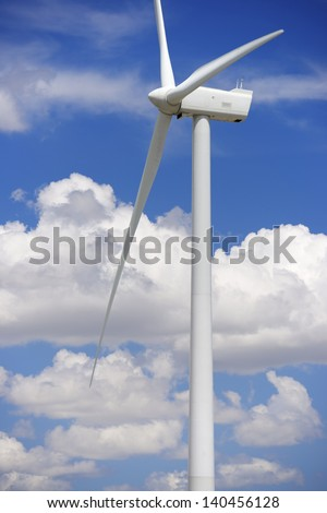 windturbine for electric energy production with white clouds