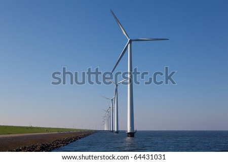 Windturbine in the water located in the Netherlands - stock photo