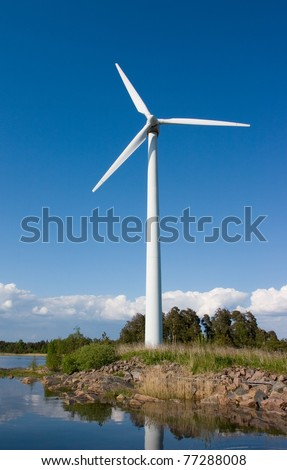 Windturbine on small island - stock photo