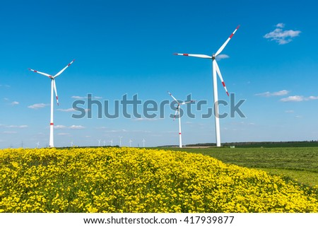 Windwheels and yellow flowers seen in rural Germany