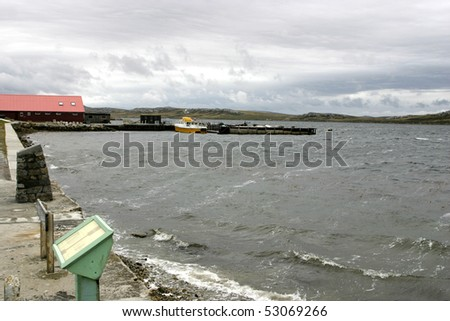 Windy and roug weather makes waves in bay of Port Stanley, Falklands - stock photo