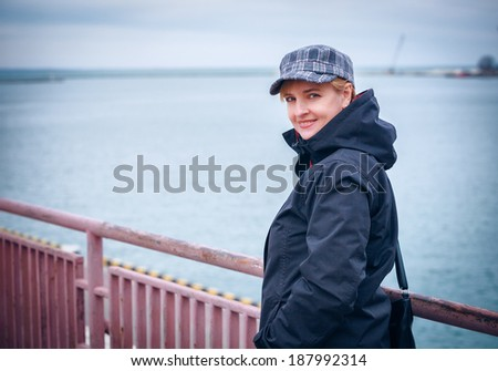 Windy autumn days relaxing on coast - stock photo