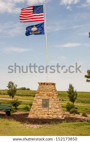 Windy day at the center of the continental United States near Lebanon, Kansas - stock photo