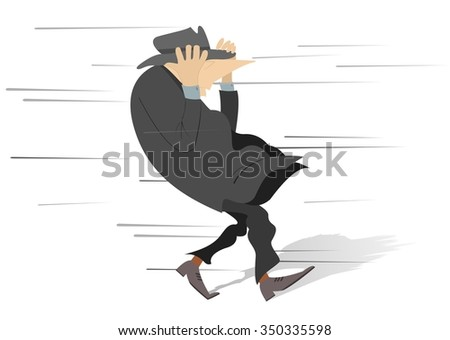 Windy day. Man tries to keep a hat on his head  - stock photo