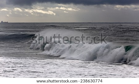 Windy white waves near the portuguese coast. - stock photo