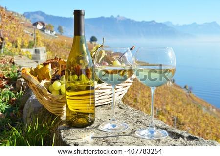 Wine against vineyards in Lavaux, Switzerland - stock photo
