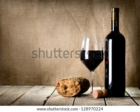 Wine and  bread on the wooden table - stock photo