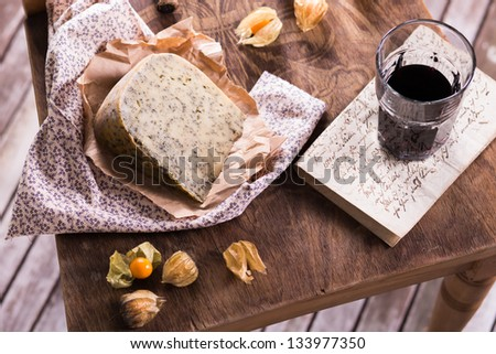 Wine and cheese a still life composition - stock photo