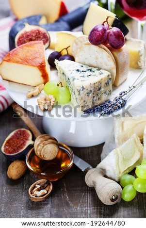 Wine and cheese plate - close up image - stock photo