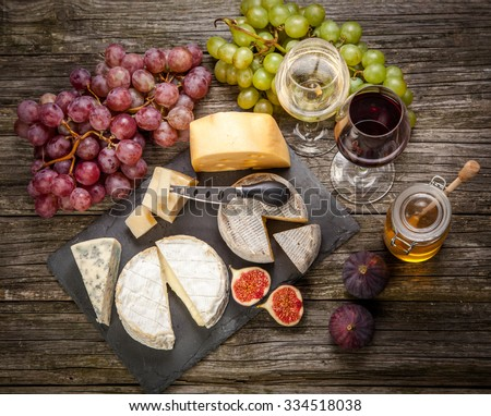 Wine and cheese still life - stock photo