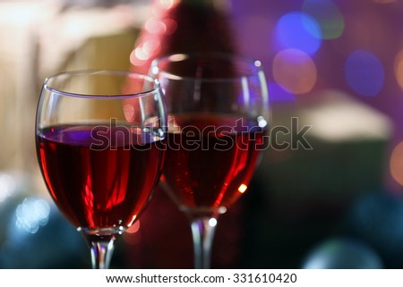 Wine and Christmas decoration on bright background - stock photo