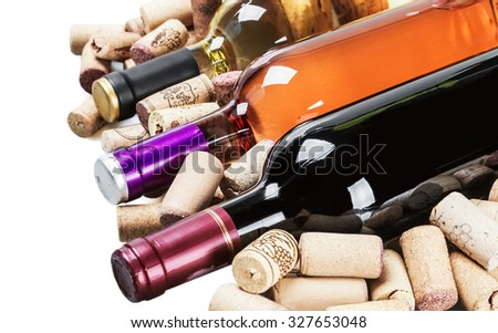 Wine and corks isolated on white background. Focus on the middle of the bottle - stock photo