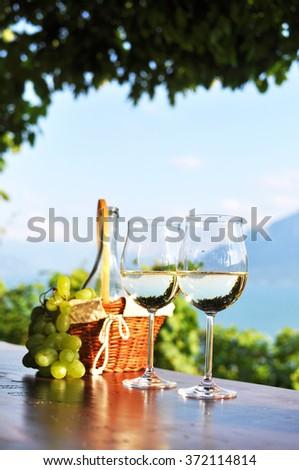 Wine and grapes against Geneva lake. Lavaux region, Switzerland - stock photo