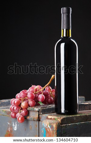 Wine and grapes on a wooden table - stock photo
