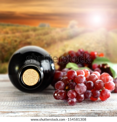 wine and red grapes fruits on table  - stock photo