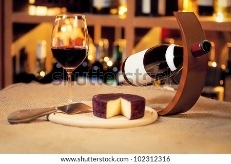 Wine and wineglass and cheese on the table