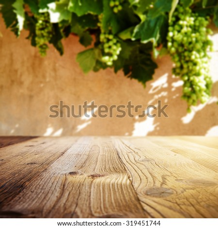 Wine background. Autumn design with vineyard and empty display. Autumn grapes harvest - stock photo