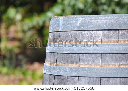 Wine Barrel and Vineyard in Background - stock photo