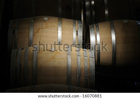 Wine barrels in a dark cavern while wine ferments