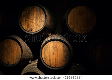 Wine barrels in a old wine cellar Wooden oak wine barrel - stock photo