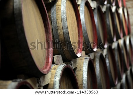 Wine barrels in an underground cellar - stock photo
