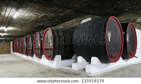 wine barrels in the cellars - stock photo