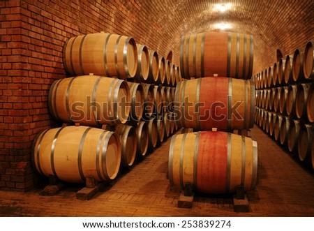 Wine barrels in wine cellar - stock photo