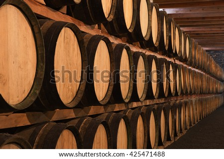 Wine barrels in wine cellar in order