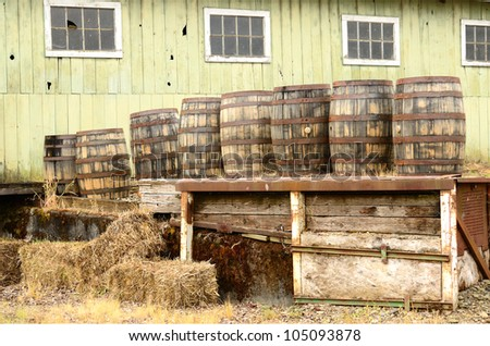 Wine barrels sitting on a loading dock at a large winery and beer brewery in the Willamette Valley near Portland Oregon