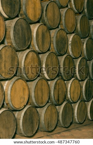 stacked oak barrels maturing red wine. Stacked Oak Barrels. Barrels Top. Wine In The Old Cellar Of Winery Maturing Red ,