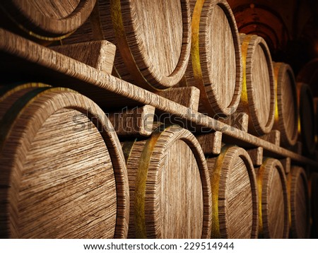 Wine barrels stacked in wine cellar. - stock photo