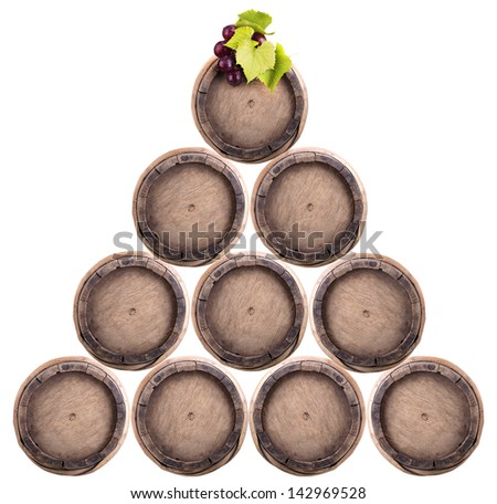 Wine barrels with grapevine in pyramid isolated - stock photo