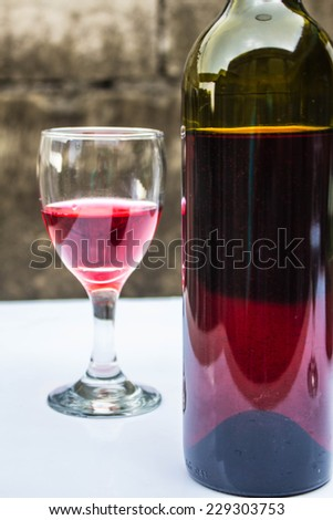 Wine bottle and glass on the table at parties.