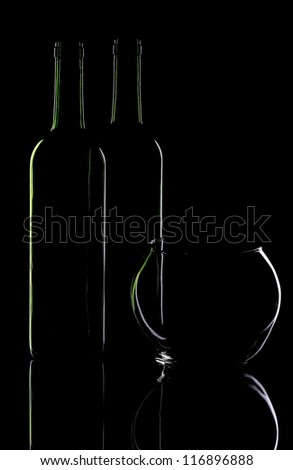 Wine bottle and glass vase on a black background