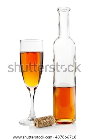 Wine bottle and goblet on white background